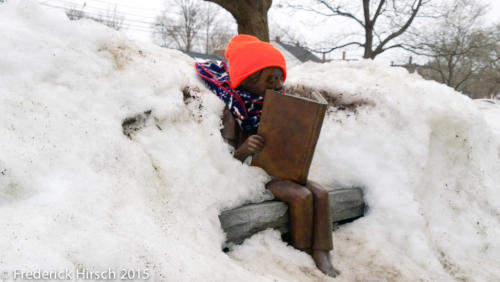 Statue of Reader in the snow at Melrose MA public library, 2015